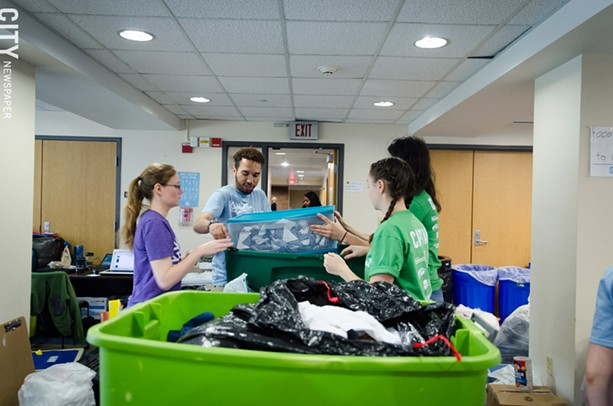 RIT volunteers sort through items collected through the Goodbye, Goodbuy! effort. - PHOTO BY MARK CHAMBERLIN