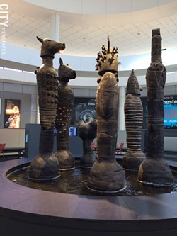 "Still on view at the Rochester airport: ""The Council,"" by Bill Stewart. - PHOTO BY MARY ANNA TOWLER"
