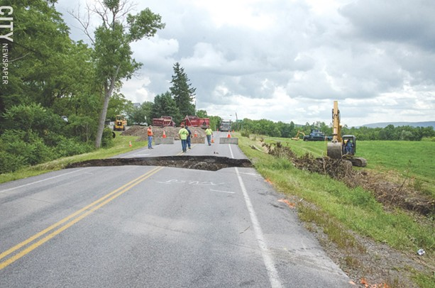 An extremely heavy downpour washed out sections of road in the Town of Richmond in June 2015. The same thing happened the previous summer. More frequent, heavier downpours are associated with climate change. - FILE PHOTO