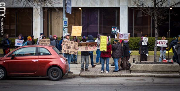 After President Donald Trump signed orders to speed up reviews of the Dakota Access and Keystone XL pipelines, groups across the country organized protests. Friday's demonstration in front of the Federal Building on State Street was one of them. - PHOTO BY KEVIN FULLER