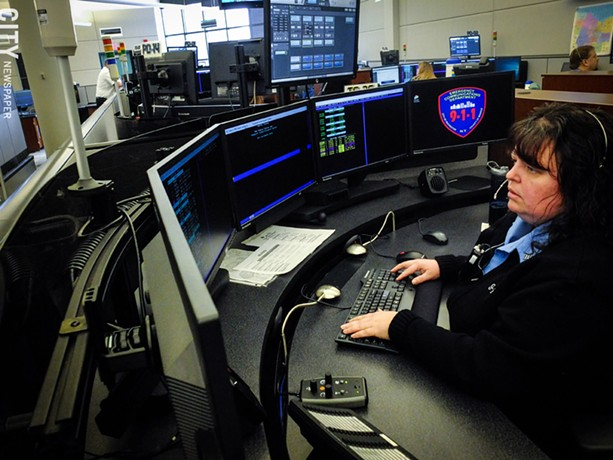 Police dispatcher Dawn LaForce handles calls at Monroe County's 911 center, which provides dispatching services for emergency service agencies across the county. - PHOTO BY KEVIN FULLER