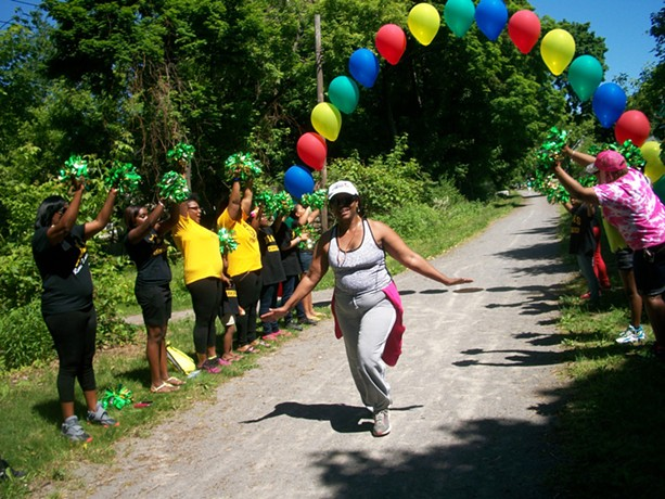 A runner crosses the finish line in a 5K run on El Camino Trail in the city's northeast. - PROVIDED PHOTO