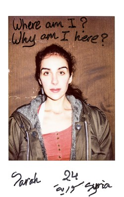 "An image from ""Take me to Jermany,"" a series of Polaroids of refugees taken by Charlotte Schmitz. - PHOTO PROVIDED"