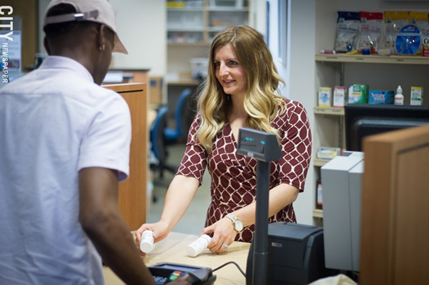 Pharmacist Ashley Zuppelli, Trillium Health's director of innovative services, in the Trillium pharmacy. - PHOTO BY KEVIN FULLER