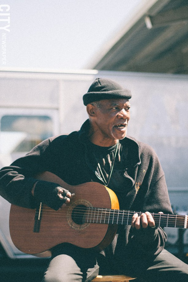 """Bluesman John McClary, who has been playing guitar since he was 7 years old, plays at the market most Saturdays: - """"Sometimes I come on Thursday, but ain't nothing happening."""" - PHOTO BY KEVIN FULLER"""