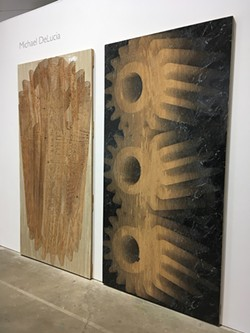 Michael DeLucia carved into plywood panels using a router attached to a CNC machine; the panels are at once low-relief sculptures, potential printing plates, and prints. - PHOTO BY REBECCA RAFFERTY