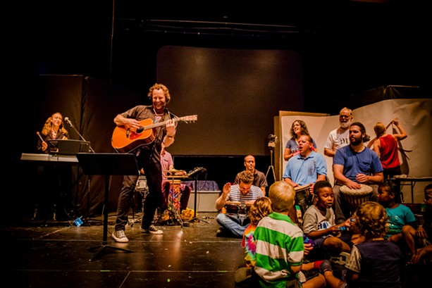 Topher Holt and is bandmates playing for kids at the School of the Arts on Sunday. - PHOTO BY JOSH SAUNDERS
