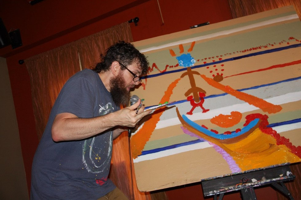 Seth Faergolzia paints while looping music during his show at Abilene. - PHOTO BY FRANK DE BLASE