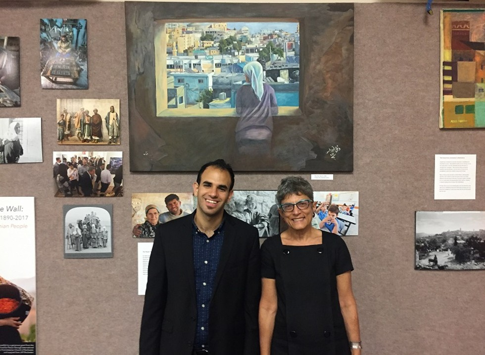 "Bshara Nassar and Mary Panzer, co-curators of ""Bethlehem Beyond the Wall,"" an exhibit of the Museum of the Palestinian People currently installed at Nazareth College. - PHOTO BY KURT INDOVINA"