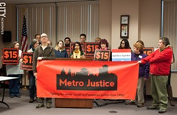 Mohini Sharma, organizer at Metro Justice, speaks during a press conference on a Trump administration proposal affecting workers' tips. - PHOTO BY JACOB WALSH