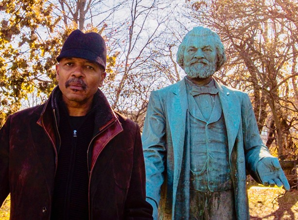 """Re-Energizing the Legacy of Frederick Douglass"" project director Carvin Eison with the statue of Frederick Douglass in Highland Park. The statue will be moved to South and Robinson this spring, and is at the center of several upcoming art-related events. - PHOTO COURTESY CARVIN EISON"