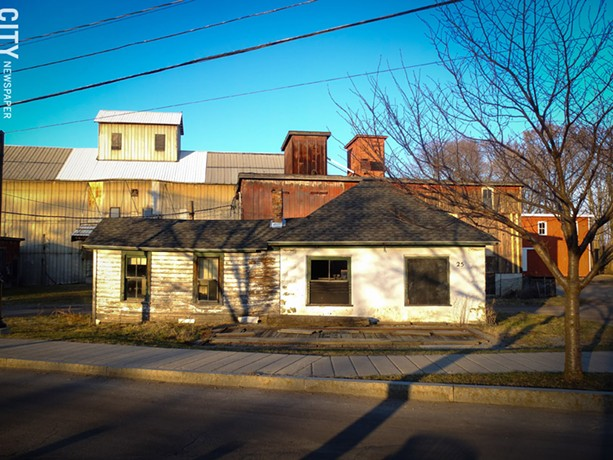 Wilmorite has temporarily withdrawn plans to redevelop 25 Schoen Place in the Village of Pittsford. The property is located in the village's popular canalfront business district. - FILE PHOTO