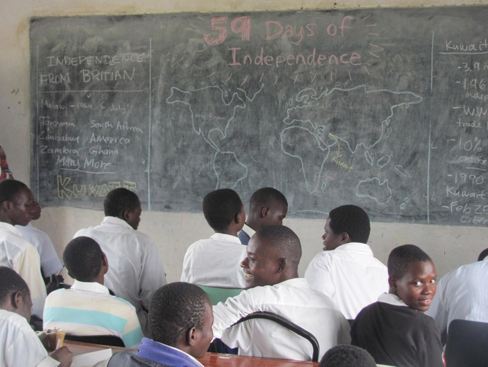 "In 2014 Layton and Bailey invited thousands of people to collaborate on their ""59 Days of Independence"" project, which told the stories of former colonies through events, installations, and celebrations. Pictured: Students in Malawi learn about the country of Kuwait on Kuwait's independence day (February 25). - PROVIDED PHOTO"