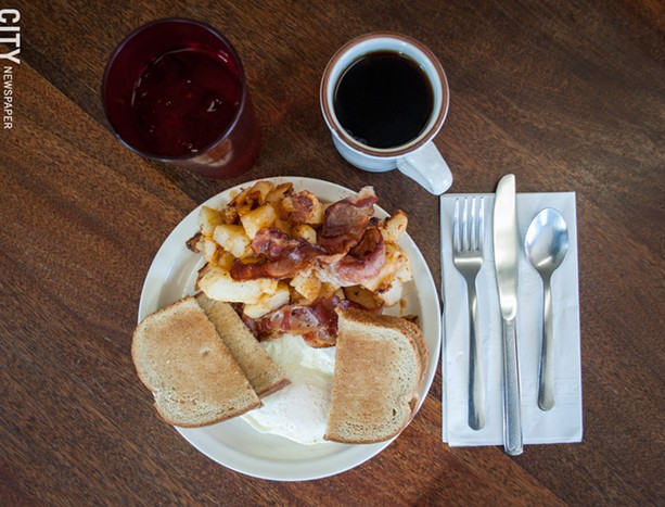 Two eggs over-easy, rye toast, bacon, and home fries at Pat's Coffee Mug. - PHOTO BY JACOB WALSH