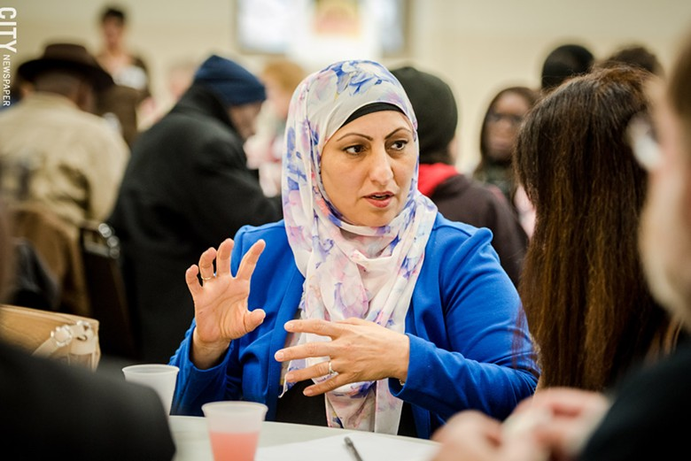 Obaida Omar, representing Catholic Family Center's Refugee Resettlement program, spoke about the challenges many refugees face when they reach the US. - PHOTO BY JOSH SAUNDERS
