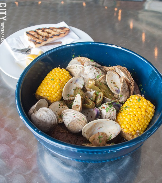A Seafood Boil Bucket at Jetty at the Port. The restaurant recently made changes to the menu to transition to a casual, beachy feel. - PHOTO BY JACOB WALSH
