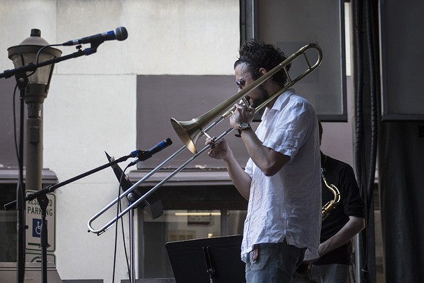 Rochester trombonist Abe Nouri played the Jazz Street Stage on Saturday at the Jazz Festival. - PHOTO BY ASHLEIGH DESKINS
