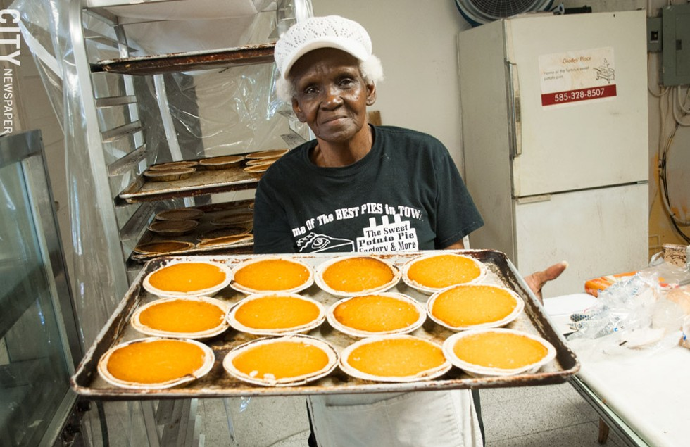 Alberta Jacque presents a tray of fresh pies at Sweet Potato Pie Factory & More. - PHOTO BY JACOB WALSH