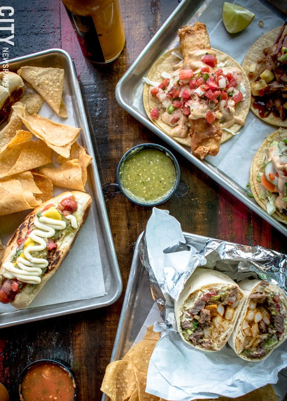 Old Pueblo Grill offers everything from traditional varieties of burritos and tacos to the Tucson dog (pictured on left), which is a regional favorite brought to Rochester by Chef Joe Zolnierowski. - PHOTO BY RYAN WILLIAMSON
