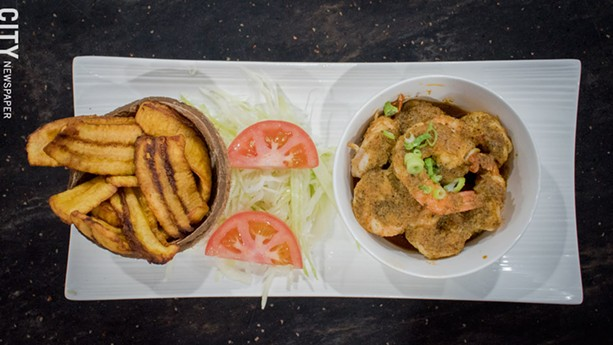 A side of Plátanos Maduros (fried plantains) and Olla de Camarones al Ajillo (Garlic Shrimp Bowl) and  at MamaJuana Roc. - PHOTO BY RYAN WILLIAMSON