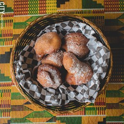 Bofrot (puff puff) is a sweet pastry on the menu at Akwaaba. - PHOTO BY RYAN WILLIAMSON
