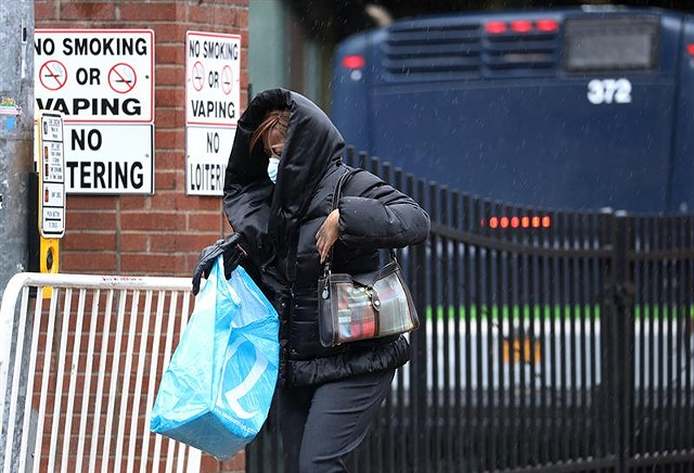 A woman exits her bus outside the Transit Center. The Regional Transit Service is urging riders to avoid taking the bus if they can.