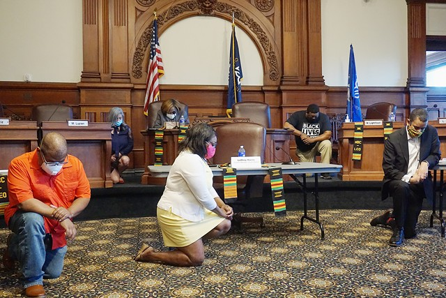 Rochester City Council members kneel in reference to the killing of George Floyd before a news conference on June 15, 2020.