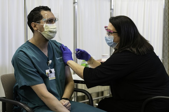 On Dec. 14, 2020, transportation worker Carlos Rosa was the first of 10 employees at the University of Rochester Medical Center to receive their first dose of the Pfizer-BioNTech COVID-19 vaccine.