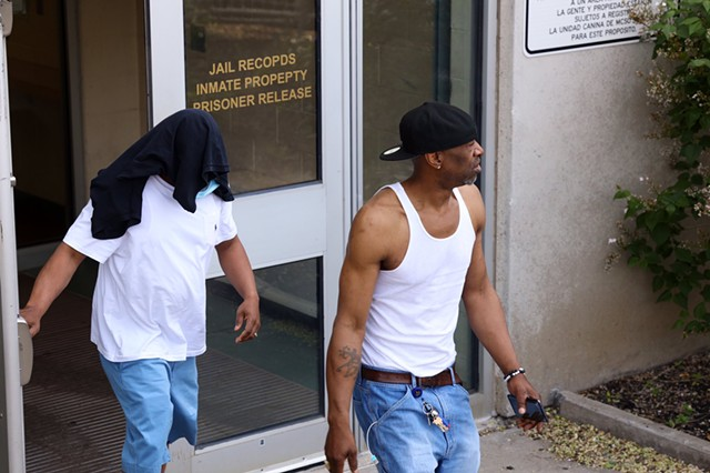 Timothy Granison, left, with head covered, leaves the Monroe County Jail after his arraignment.