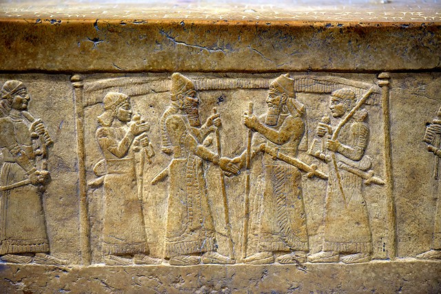 One of the earliest known depictions of a handshake is 9th-century B.C.E. carving depicting the Assyrian king Shalmaneser III shaking the hand of the Babylonian king Marduk-zakir-shumi I to seal an alliance.