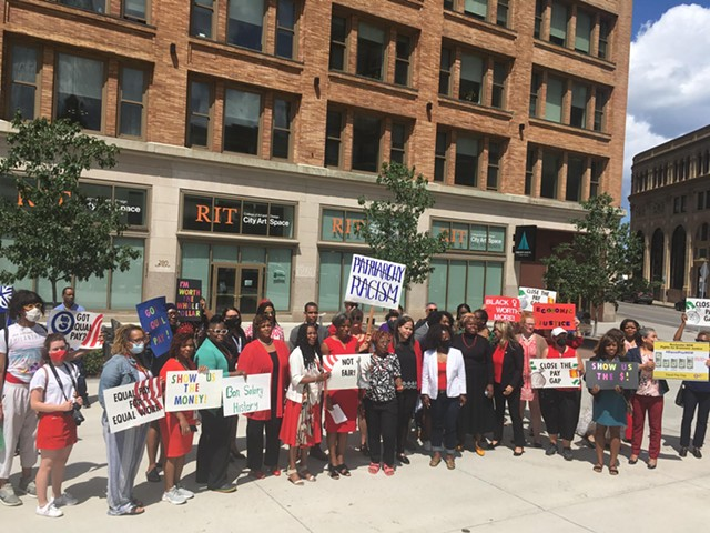Community members wore red and gathered at the Liberty Pole in downtown Rochester on Aug. 3 in honor of National Black Women's Equal Pay Day.
