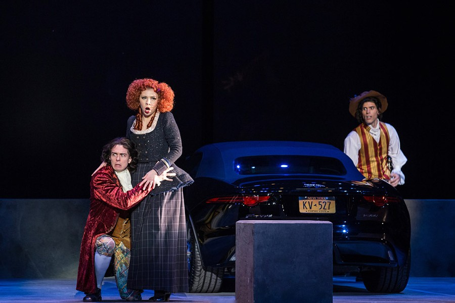 """From left to right: Michael Galvin  as Leporello, Maria Vasilevskaya as Donna Elvira, and Michael Aiello as Don Giovanni in Eastman Opera Theatre's """"Don Giovanni."""" - PHOTO BY NIC MINETOR"""