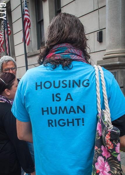 Housing activist Ryan Acuff outside of the Monroe County Office Building prior to a state Assembly hearing on rental housing and tenant protections. - PHOTO BY RYAN WILLIAMSON