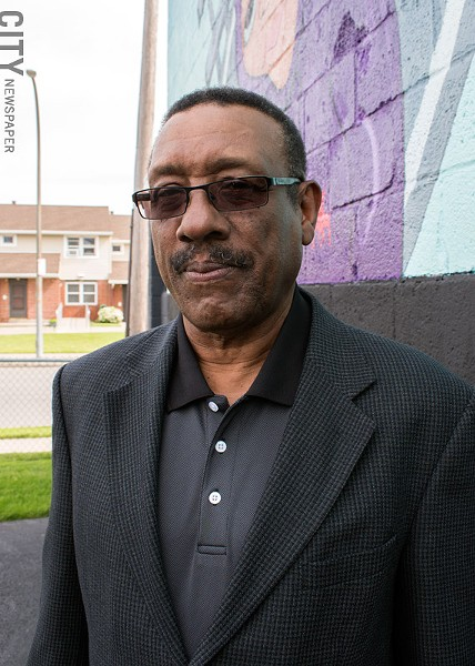 "Baden Street Settlement House's Ron Thomas in the Northeast District: ""Rebuilding a neighborhood, where there's a mix of people of all races, all denominations."" - PHOTO BY RENÉE HEININGER"