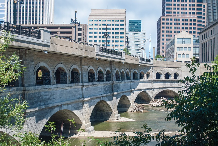 The city plans to remove the upper portion of the Broad Street bridge – the roadway and the row of arches below it – and take the bridge back to the elevation of the original Erie Canal. The bottom set of arches are the canal's original set. - FILE PHOTO