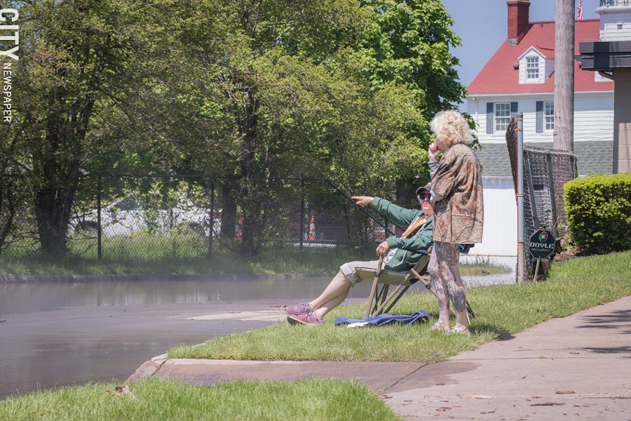 Two people survey flooding in Summerville. - PHOTO BY RYAN WILLIAMSON
