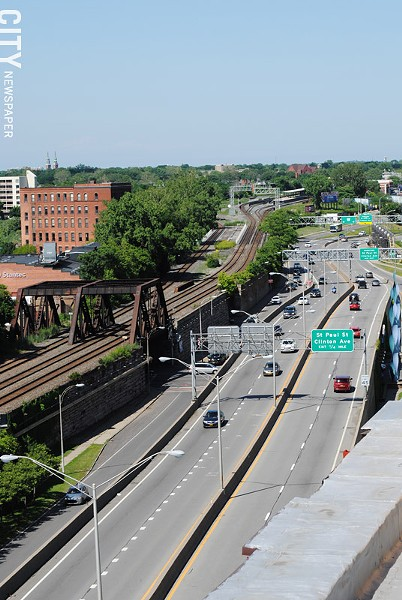 The Inner Loop looking east from Plymouth Avenue: The highway gives motorists a quick route across the northern portion of downtown Rochester, but it creates a barrier between downtown and neighborhoods to the north. - PHOTO BY RYAN WILLIAMSON