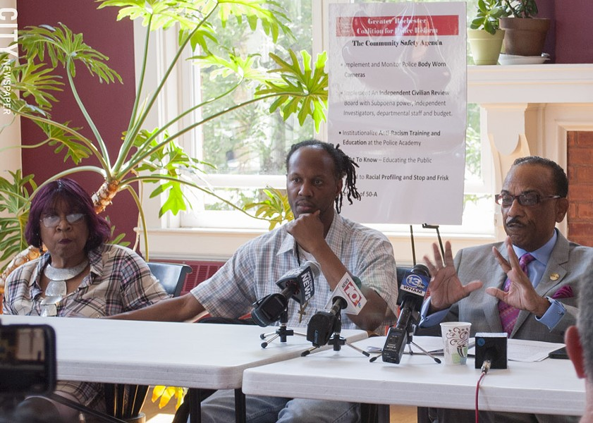 Christopher Pate (center) with his mother and the Rev. Lewis Stewart at a news conference in early August. - PHOTO BY RENEE HEININGER