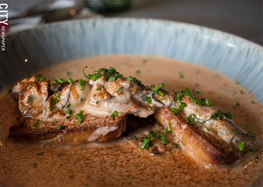The Oyster Pan Roast: tender oysters served on top of lightly toasted bread, floating in a delightfully rich tomato cream-based sauce. - PHOTO BY JACOB WALSH
