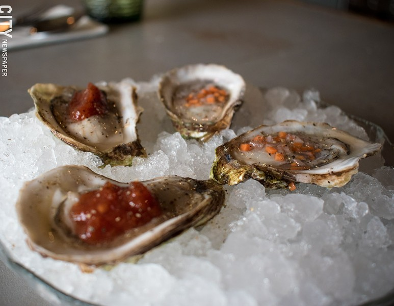 Fresh, briny oysters with zesty cocktail sauce and vinegary mignonette. - PHOTO BY JACOB WALSH