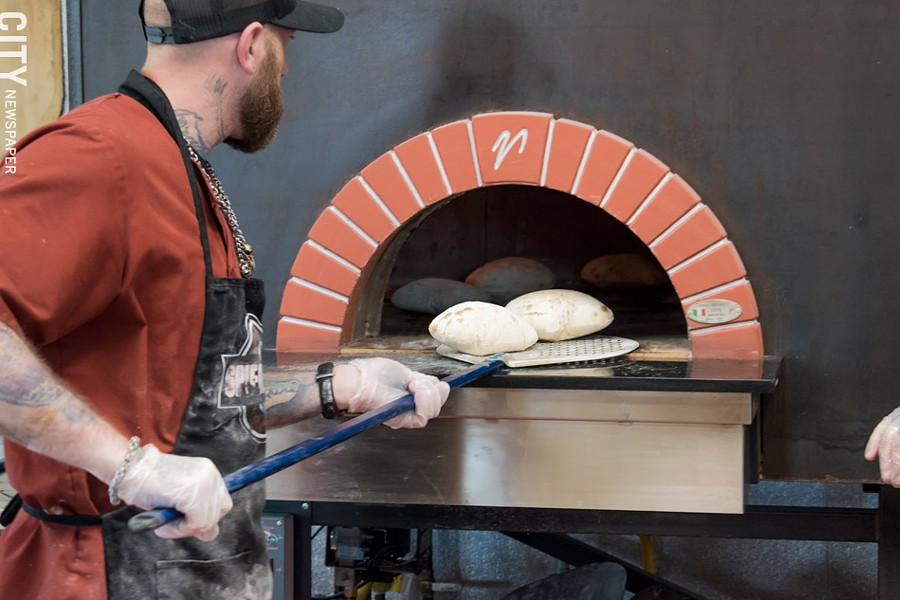 The bread is made with a 100-year-old Neapolitan recipe, with a high-gluten flour and brick-oven baked. - PHOTO BY JACOB WALSH