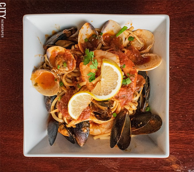 Pasta and seafood tossed in a spicy-hot diavolo sauce. - PHOTO BY JACOB WALSH