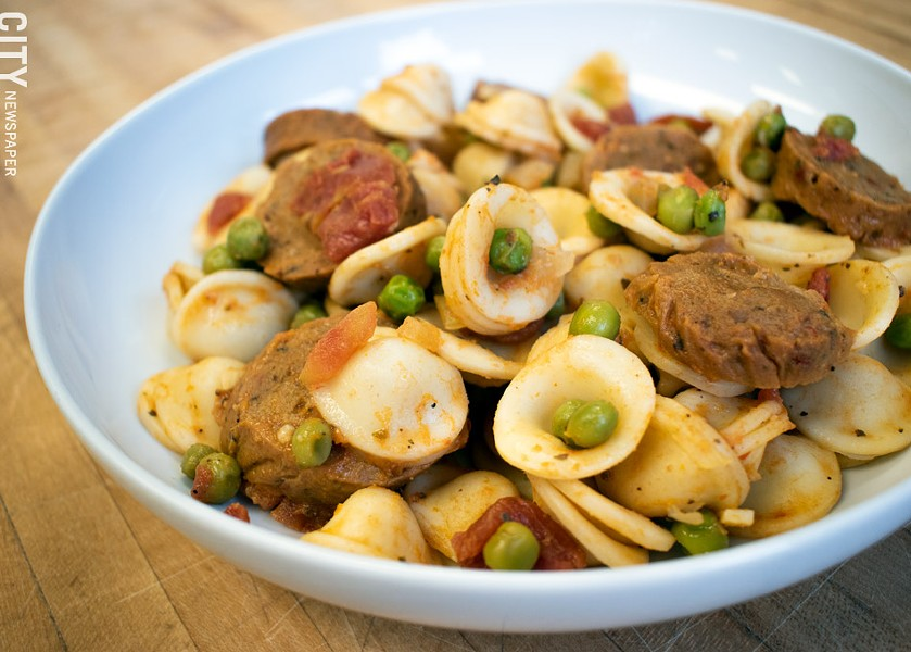 "Conchiglie alla Burino, made with vegan butter, Grass Fed's Italian ""sausage,"" tomatoes, white wine, garlic, onions, and peas. - PHOTO BY RENÉE HEININGER"