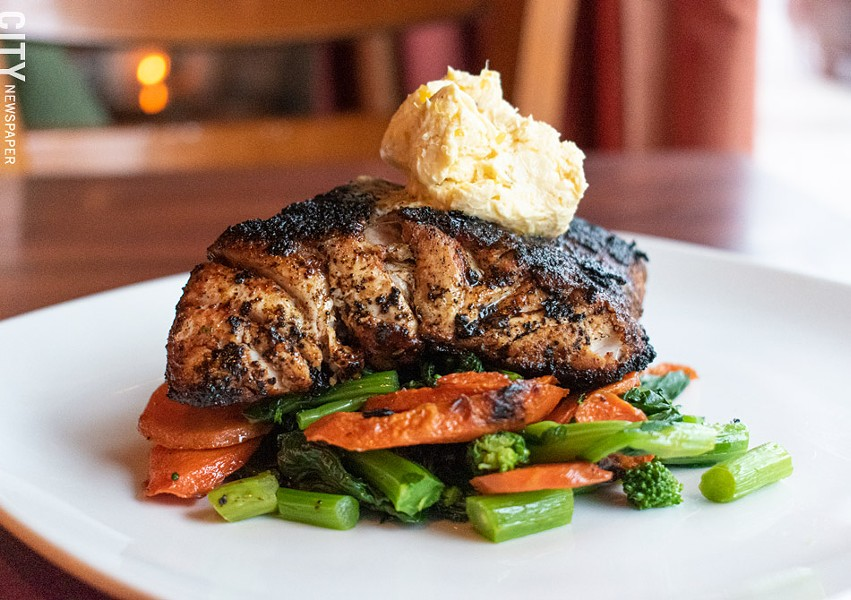 Blackened red snapper with yellow pepper butter, carrots, and sauteed broccoli rabe. - PHOTO BY JACOB WALSH