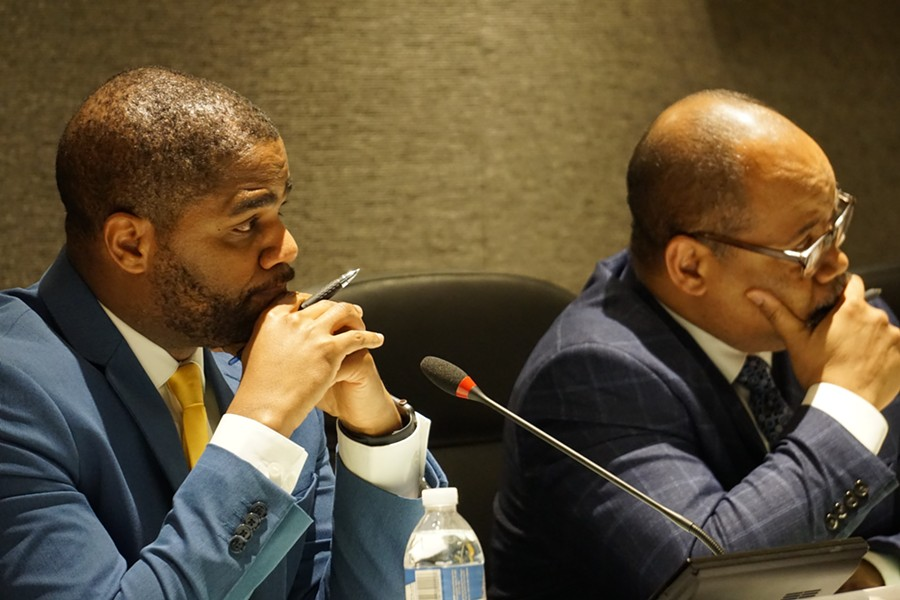Superintendent Terry Dade and school board President Van White listen to one of the 95 speakers at Thursday night's meeting. - PHOTO BY GINO FANELLI