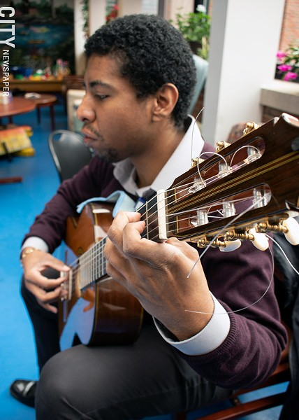 Classical guitarist Michael Anthony Jones performs at Strong Hospital. - PHOTO BY RENÉE HEININGER