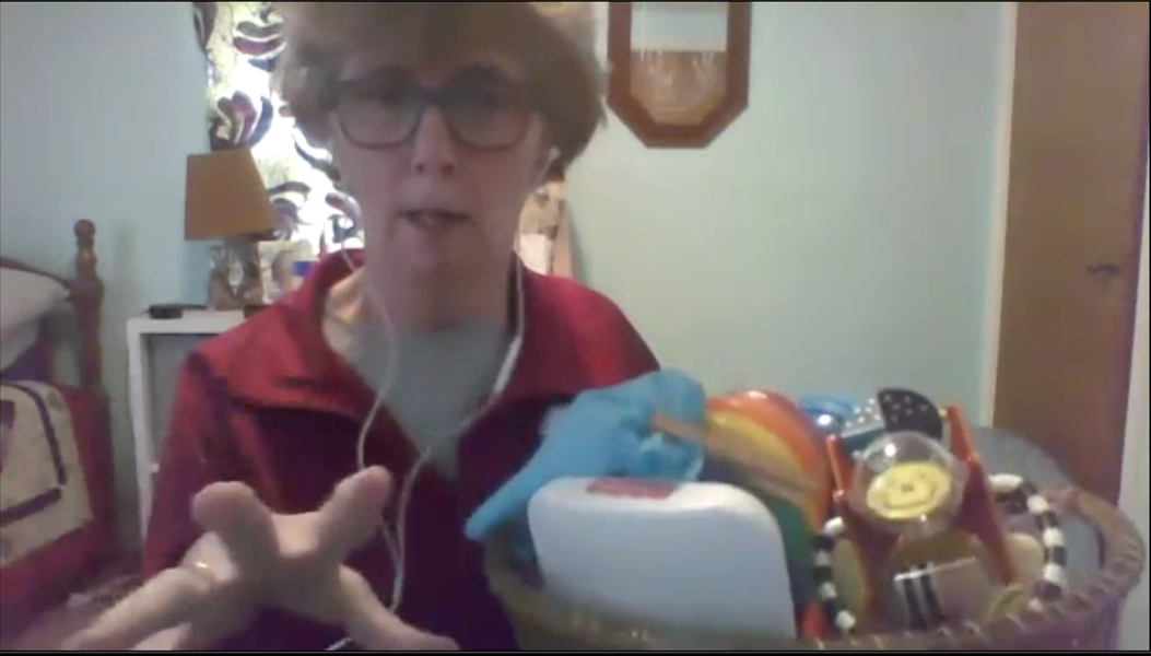 Physical therapist Janet Rosenberg holds a basket of toys that she uses in virtual early intervention therapy sessions to show caregivers how to encourage young children to move. - WXXI NEWS AND STEP BY STEP DEVELOPMENTAL SERVICES