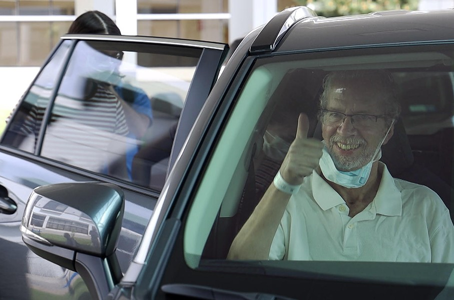 Ted O'Brien, the assistant state state attorney general for the Rochester region, flashes a thumbs-up as he leaves Unity Hospital in Greece after 68 days hospitalized for COVID-19. - PHOTO BY MAX SCHULTE