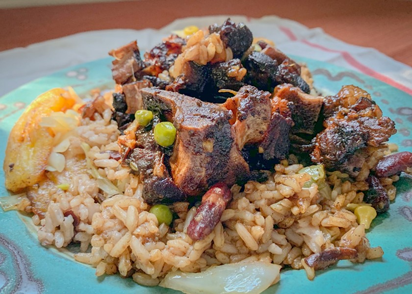 Jerk oxtail, rice and beans, and sweet plantains at Pan-Cart on East Main Street. - FILE PHOTO