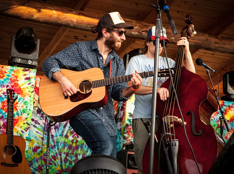 Max Flansburg (left) performing with Dirty Blanket at Lincoln Hill Farms on July 3. - PHOTO BY TOM FUCILLO